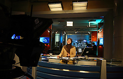 News anchor Dr. Zeinab Al-Saffar jokes between takes at Al Manar television station, Beirut, Lebanon, March 31, 2006. Al Manar is run by Hezbollah. While recently banned in the U.S., the station's reported goal is to preserve the Islamic values and enhance the civilized role of the Arab and Islamic community.