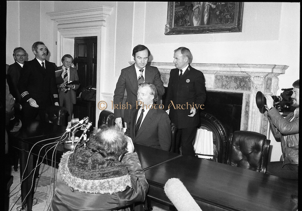 Charles Haughey,New Fianna Fáil Leader  (N5)..1979..07.12.1979..12.07.1979..7th December 1979..Today saw the election of Mr Charles Haughey as leader of Fianna Fáil. Mr Haughey takes over the role after the resignation of Jack Lynch.In a surprise result Mr Haughey beat the party favourite Mr George Colley TD..Image shows Mr Haughey TD after he took his place at the top table, the Dáil usher shows Dr Michael Woods TD to his seat.