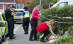 **PERMISSION GIVEN BY MOTHER OF GIRL FOR PICTURE TO BE USED ** © London News Pictures. 10/06/2012.  Ampthill, UK. A Friend of Megan-Leigh Peat  laying flowers outside the property where 15-year-old Megan died in the early hours of Saturday morning. Schoolgirl Megan-Leigh Peat was stabbed to death at a house party thrown by a boy whose parents are away on holiday. Photo credit: Ben Cawthra/LNP