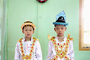 Shinbyu Novice Ceremony on 25th March 2016 in Loikaw, Kayah State, Myanmar. In Myanmar, it is customary for boys to enter the monastery as a Buddhist novice between the age of ten and 20 years old although they can be as young as four, for at least one week. During the ceremony, which lasts two or sometimes three days, the boys are dressed and made-up to be a prince and paraded through the village before being ordained as novice monks.