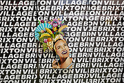 As the second week of the Coronavirus lockdown continues around the capital, and the UK death toll rising by 563 to 2,325, with 800,000 reported cases of Covid-19 worldwide, in accordance with the government's forced lockdown and closure of businesses, an image of Carmen Miranda appears against the repeated lettering of Brixton Village market, a now empty arcade and closed small local businesses in south London, on 31st March 2020, in London, England.