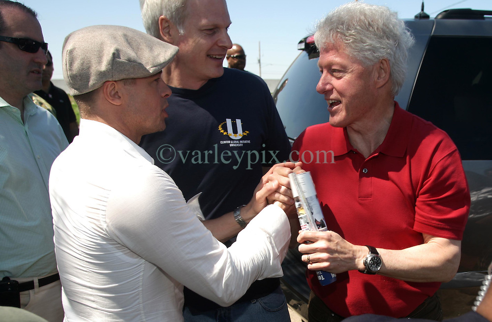 16 March 2008. New Orleans, Louisiana. Lower 9th ward.<br /> Former President Bill Clinton and movie star Brad Pitt say their goodbyes as the former Preident gets set to depart. The men were in town for the 'Make a Difference, Make a Commitment' clean up of the neighbourhood devastated by Hurricane Katrina. The massive clean up project was organised by Brad Pitt's Make it Right Foundation aided by the Clinton Global Initiative.<br /> Photo credit; Charlie Varley.