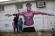 Painting by Langston Allston, a New Orleans artist of one of the mourners he painted durring a vigil for Alton Sterling at the Triple S Food Mart, Wednesday, July 6, 2016.