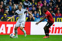 Swansea Defender Angel Rangel (ESP) is challenged by Man Utd Defender Patrice Evra (FRA) during the first half of the match - Photo mandatory by-line: Rogan Thomson/JMP - Tel: Mobile: 07966 386802 17/08/2013 - SPORT - FOOTBALL - Liberty Stadium, Swansea -  Swansea City V Manchester United - Barclays Premier League - First round of the 2013/14 season and the first league match for new Man Utd manager David Moyes.
