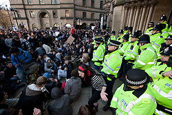 © under license to London News Pictures. 24/11/2010: Students in Manchester protest against cutbacks and the coalition government's proposed rise in tuition fees. After failing to gain access to the Town Hall, protesters staged a sit-down protest outside.