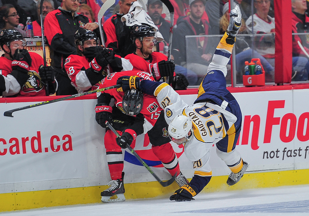 October 17, 2015: Nashville Predators Center Paul Gaustad (28) [2616] is sent crashing to the ice by Ottawa Senators Center Zack Smith (15) [6906] during the NHL game between the Ottawa Senators and the Nashville Predators at the Canadian Tires Centre in Ottawa, ON. (Photo by Steve Kingsman/Icon Sportswire)