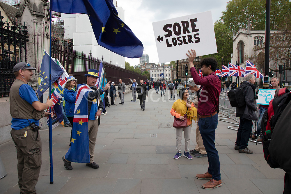 Anti Brexit and pro Brexit protest proclaiming that they are sore losers in Westminster on 7th May 2019 in London, England, United Kingdom.