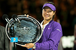 © Licensed to London News Pictures. 26/01/2013. Melbourne Park, Australia. Li Na holds up the runners up trophy during the Womens Final between Victoria Azarenka and Li Na of the Australian Open. Photo credit : Asanka Brendon Ratnayake/LNP