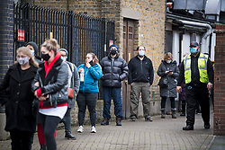 © Licensed to London News Pictures. 03/02/2021. London, UK. Member of the public queue at a new Variant Testing Centre in Ealing, West London, set up after the discovery of a new South African variant of coronavirus. Door-to-door delivery of free home test kits is to start in the area in an attempt to slow the spread of the more aggressive strain of the virus. Photo credit: Ben Cawthra/LNP