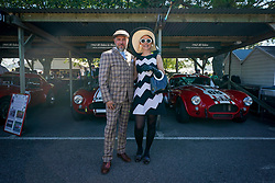 © Licensed to London News Pictures. <br /> 13/09/2019. <br /> Goodwood.West, Sussex. UK.<br /> The Goodwood Motor Circuit celebrates the 21st year of the Revival.This has become one of the biggest annual historic motorsport events in the world and the only one to be staged entirely in period dress. Each year over 150,000 people descend on this quiet corner of West Sussex to enjoy the three-day event.<br /> Pictured a couple in period dress.<br /> Photo credit: Ian Whittaker/LNP