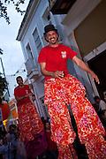 Stiltwalkers during the Festival of San Sebastian in San Juan, Puerto Rico.