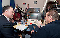 """Congressman Frank Guinta presents WEZS talk radio host Niel Young with a proclamation Saturday morning to celebrate his 15 years on the air broadcasting """"The Advocates"""".  (Karen Bobotas/for the Laconia Daily Sun)"""