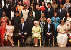 Queen Elizabeth II (centre front) with the Duke and Duchess of Sussex (left front) during a group photo at the Queen's Young Leaders Awards Ceremony at Buckingham Palace, London.