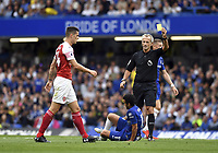 Football - 2018 / 2019 Premier League - Chelsea vs. Arsenal<br /> <br /> Arsenal's Granit Xhaka is shown a yellow card by Referee Martin Atkinson, at Stamford Bridge.<br /> <br /> COLORSPORT/ASHLEY WESTERN