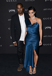 File photo dated November 1, 2014 of Kanye West and Kim Kardashian attend the 2014 LACMA Art + Film Gala honoring Barbara Kruger and Quentin Tarantino presented by Gucci at LACMA in Los Angeles, CA, USA. US rapper Kanye West took to Twitter over the weekend to announce he was running for president, with his declaration quickly going viral and prompting a flurry of speculation. His wife Kim Kardashian West and entrepreneur Elon Musk endorsed him. Photo by Lionel Hahn/ABACAPRESS.COM