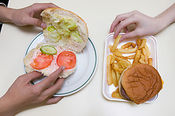 School meals of prawn and salad roll or a carton of burger and chips; government guidelines encourage schools to replace less healthy options with more fresh fruit; vegetables and fish,