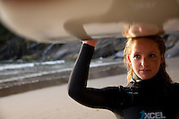 Portrait of woman surfing at Oswald West State Park, OR.