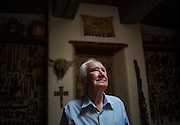 """Forrest Fenn, shown on June 17, 2016 at his home in Santa Fe, New Mex., surrounded by thousands of artifacts he has collected from years as an art dealer. In 2010 Fenn hid a treasure and wrote a poem and a book, """"The Thrill of the Chase,"""" with clues on how to find it."""