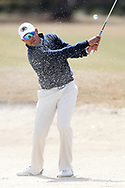 WILMINGTON, NC - MARCH 19: Kent State's Chase Johnson hits out of a bunker on the Marsh Course first hole. The first round of the 2017 Seahawk Intercollegiate Men's Golf Tournament was held on March 19, 2017, at the Country Club of Landover Nicklaus Course in Wilmington, NC.