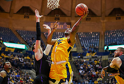 Mar 20, 2019; Morgantown, WV, USA; West Virginia Mountaineers forward Derek Culver (1) shoots in the lane during the second half against the Grand Canyon Antelopes at WVU Coliseum. Mandatory Credit: Ben Queen