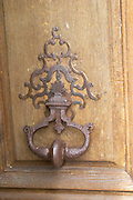 Old iron Door knocker on the wooden entrance door. Chateau de Cerons (Cérons) Sauternes Gironde Aquitaine France