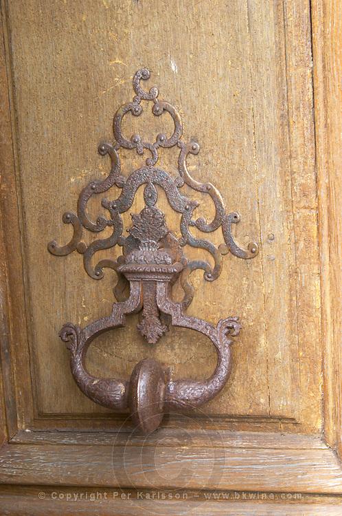 Old iron Door knocker on the wooden entrance door. Chateau de Cerons (Cérons) Sauternes Gironde Aquitaine France