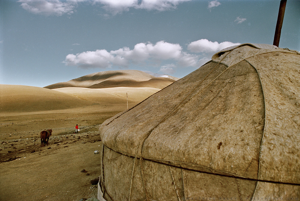 Fetching water at a summer settlement of yurts, also called Gers, the traditional Mongolian house made of felt, in Western Mongolia, in the Province of Bayan Olgii, at the base of the Tsaast uul mountain.