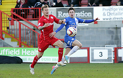 Peterborough United's Tommy Rowe in action with Crawley Town's Kyle McFadzean - Photo mandatory by-line: Joe Dent/JMP - Tel: Mobile: 07966 386802 01/03/2014 - SPORT - FOOTBALL - Crawley - Broadfield Stadium - Crawley Town v Peterborough United - Sky Bet League One