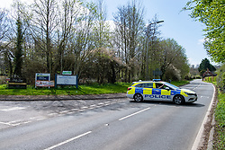 © Licensed to London News Pictures. 02/04/2021. Thatcham, UK. Police maintain a roadblock on Crookham Hill near the Thatcham Town Football Club after a woman, aged in her forties, was found with significant injuries in Crookham Hill, Crookham Common at approximatly 11:45pm on Thursday 01/04/2021 and died from her injuries. A man, aged 35, has been arrested on suspicion of murder. Photo credit: Peter Manning/LNP