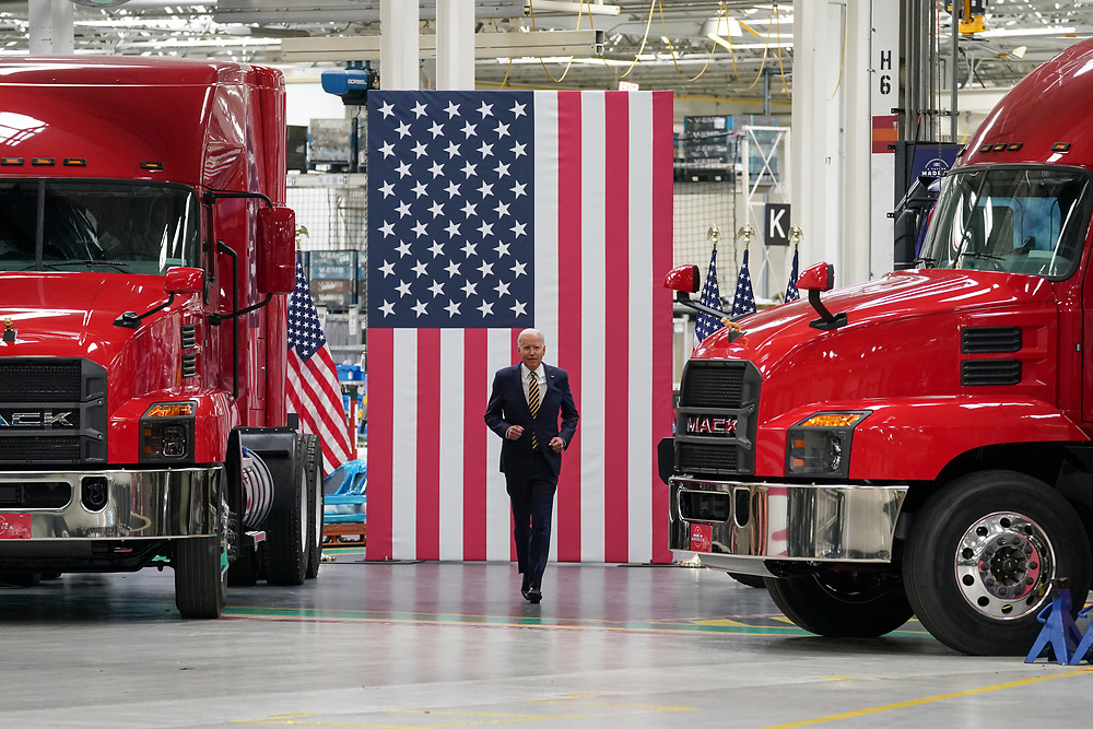 President Joe Biden runs toward the stage to give remarks July 28, 2021, following a tour of Mack Trucks Lehigh Valley Operations in Lower Macungie Township, Pennsylvania. The presidential visit was made to highlight the importance of American manufacturing, buying products made in America, and supporting good-paying jobs for American workers. (Photo by Matt Smith)
