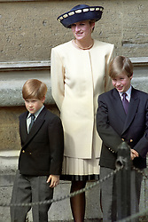 """Embargoed to 0001 Monday August 21 File photo dated 19/4/1992 of Diana, Princess of Wales with her sons, Prince William, right, and Prince Harry outside St George's Chapel in Windsor Castle. Diana, Princess of Wales was a woman whose warmth, compassion and empathy for those she met earned her the description the """"people's princess""""."""