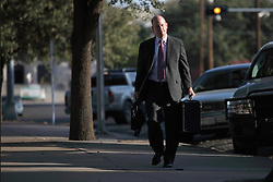 """Assistant Texas Attorney General Eric Nichols walks into the courthouse to finish the sentencing phase for Warren Jeffs, leader of the Fundamentalist Church of Jesus Christ of Latter Day Saints, San Angelo, Texas, Aug. 9, 2011. Jeffs  was sentenced to life in prison for sexually assaulting two underage girls he claimed as """"spiritual"""" brides. The Texas jury of ten women and two men deliberated for less than an hour before giving him a life sentence for one charge and 20 years for a second, the maximum sentence for both."""