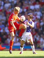 Photo. Jed Wee.<br /> Blackburn Rovers v Liverpool, FA Barclaycard Premiership, Ewood Park, Blackburn. 13/09/2003.<br /> David and Goliath. Blackburn's David Thompson (R) tangles with Liverpool's Sami Hyypia.