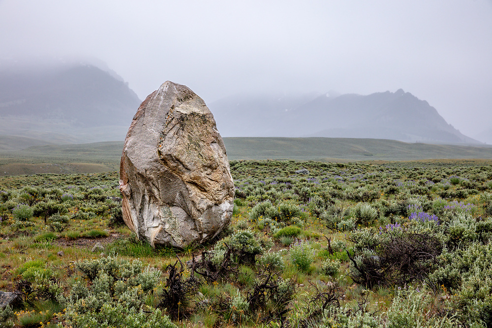 Loan Boulder left on the high elevations prairie of Copper Basin in Central Idaho was deposited by a Glacier thousands of years ago standing about 10 feet/3meters high. Licensing and Open Edition Prints.
