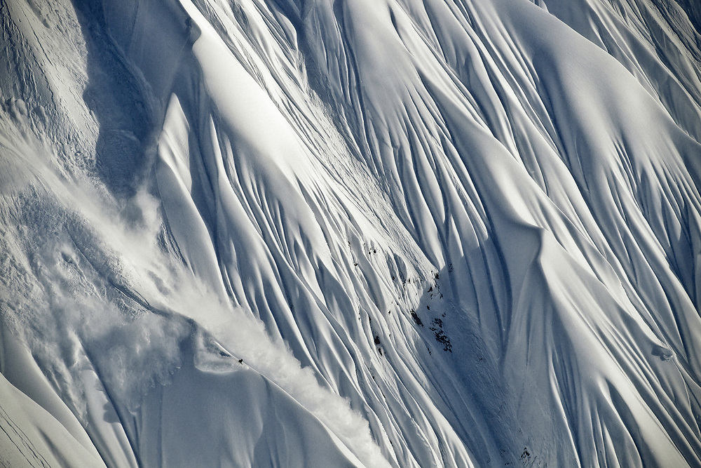 Just another day in the office for professional snowboarder Travis Rice as he negotiates his way down a steep ridge while filming in Alaska.