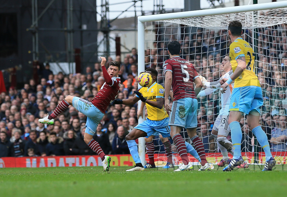 West Ham's Aaron Cresswell scoring an own goal<br /> <br /> Barclays Premier League - West Ham United  vs Crystal Palace  - Upton Park - England - 28th February 2015 - Picture David Klein/Sportimage