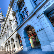 The Ferry Building along the Embarcadero and next to the bay, San Francisco, CA.