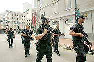 New Orleans SWAT police armed with machine guns patrol downtown New Orleans  August 30, 2005. Hurricane Katrina devastated the town and surroundings and looting was reported in the area.  REUTERS/Rick Wilking