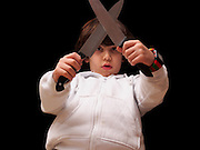 young boy attempts to fight with kitchen knives