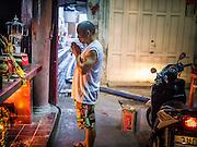 19 OCTOBER 2012 - BANGKOK, THAILAND:  A man prays at a Chinese shrine in Tha Tien Market near Tha Tien Pier and Wat Po in Bangkok, Thailand.     PHOTO BY JACK KURTZ