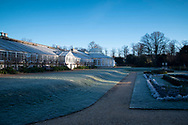 Early morning sun on the conservatory and frost covering the Italian Garden at Chiswick House, Chiswick, London, UK