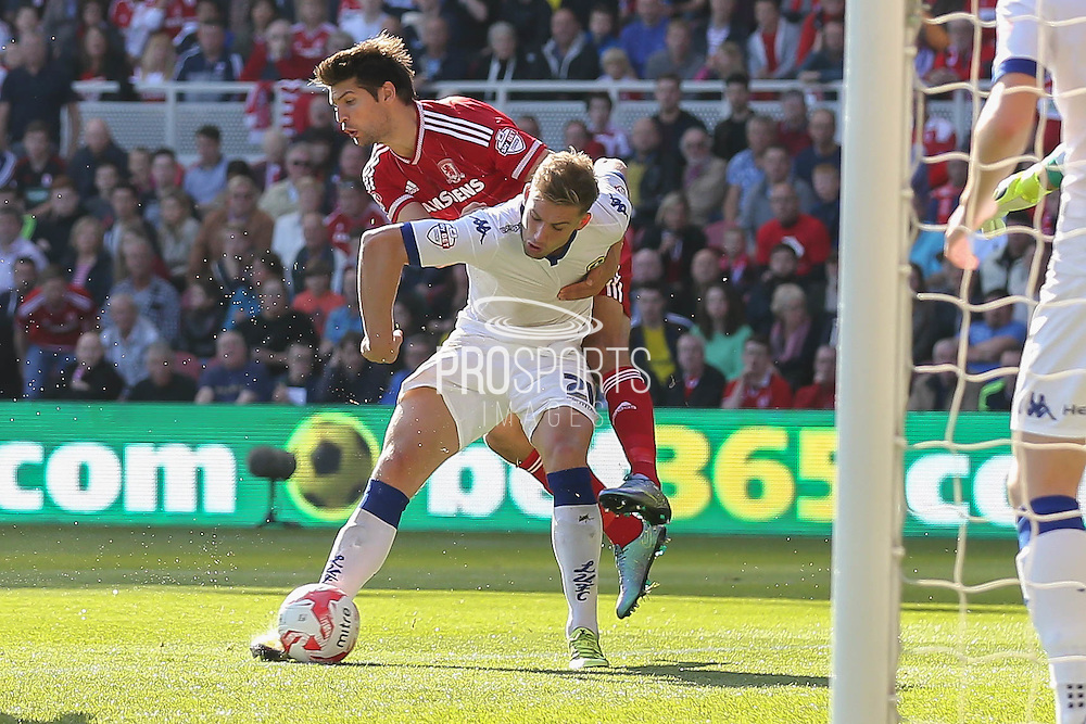 Middlesbrough defender George Friend fouls Leeds United defender Gaetano Berardi  during the Sky Bet Championship match between Middlesbrough and Leeds United at the Riverside Stadium, Middlesbrough, England on 27 September 2015. Photo by Simon Davies.