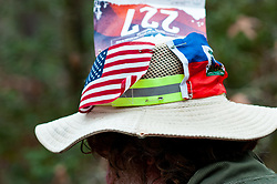 January 19, 2019 - Southern Pines, North Carolina, US - Jan. 19, 2019 - Southern Pines N.C., USA - Paul Heckert, Cullowhee, North Carolina, wears a patriotic hat as he completes a lap during the 10th Annual Weymouth Woods 100km ultra marathon at the Weymouth Woods Nature Preserve. Runners needed to complete 14 laps of the 4.47 mile course for 62.58 miles in under the 20-hour time allotment. (Credit Image: © Timothy L. Hale/ZUMA Wire)
