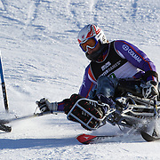 Timothy Farr, Great Britain, in action during the Men's Slalom Sitting, Adaptive Slalom competition at Coronet Peak, New Zealand during the Winter Games. Queenstown, New Zealand, 25th August 2011. Photo Tim Clayton