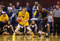 Mar 20, 2019; Morgantown, WV, USA; West Virginia Mountaineers guard Jordan McCabe (5) dribbles during the first half against the Grand Canyon Antelopes at WVU Coliseum. Mandatory Credit: Ben Queen