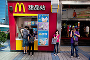 Outside a McDonalds fast food restaurant selling ice creams. Zhongguancun or Zhong Guan Cun, is a technology hub in Haidian District, Beijing, China. It is situated in the northwestern part of Beijing city. Zhongguancun is very well known in China, and is often referred to as China's Silicon Valley. This is Beijing's computer district with numerous tech companies offices situated here amongst the many malls which sell electronics and electrons equipment of all kinds. The tech park started as a small office where two decades ago some students from a nearby university decided that computer equipment may be a thing of the future so set up a small company. It has expanded in this time to  cover many square kilometres.