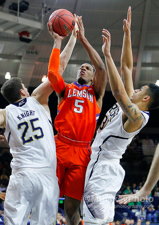 SOUTH BEND, IN - FEBRUARY 11: Jaron Blossomgame #5 of the Clemson Tigers shoots the ball between Tom Knight #25 and Zach Auguste #30 of the Notre Dame Fighting Irish at Purcel Pavilion on February 11, 2014 in South Bend, Indiana.  (Photo by Michael Hickey/Getty Images) *** Local Caption *** Jaron Blossomgame; Tom Knight; Zach Auguste