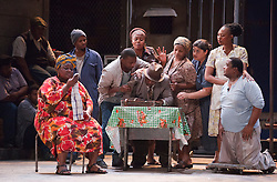 """© Licensed to London News Pictures. 10/07/2012.  London, England. Far right: Nonhlanhla Yende as Bess and Xolela Sixaba as Porgy. London Premiere of Cape Town Opera's fully-staged production of the Gershwin Opera """"Porgy and Bess"""" at the London Coliseum. A limited season of 14 performances from 11 to 21 July 2012. Directed by Christine Cross, Music/Lyrics by George Gershwin, DuBose and Dorothy Heyward and Ira Gershwin, accompanied by the Orchestra of Welsh National Opera. Photo credit: Bettina Strenske/LNP"""