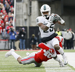 November 11, 2017 - Columbus, OH, USA - Michigan State Spartans wide receiver Darrell Stewart Jr. (25) is tackled by Ohio State Buckeyes safety Erick Smith (46) on Saturday, Nov. 11, 2017 at Ohio Stadium in Columbus, Ohio. (Credit Image: © Barbara J. Perenic/TNS via ZUMA Wire)