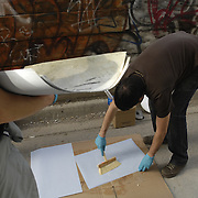 Installing reproductions of war zone graffiti taken by Louie Palu in Afghanistan being hung in alleys in Toronto, Canada with local graffiti art for the 2009 Contact Photography Festival.